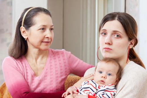 Mature woman comforts sad adult daughter